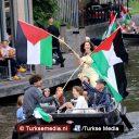 Boten door Amsterdam voor Gaza: 'Israël, stop de bezetting'