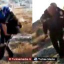 Turkse politieagent draagt gewonde Syrische moeder op zijn rug (VIDEO)